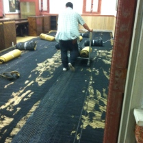 In the Conference Room the old padding had to be scraped off before installation could begin.