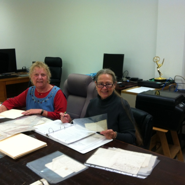 Barbara Ceriale and Sharon Parker, still cheerful after a year of sorting, deciphering, and sleeving letters.
