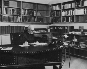 Fr. Maynard Geiger OFM, SBMAL archivist at his desk.