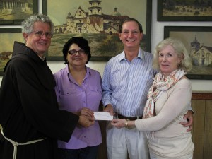 Marc and Pauline Sylvain presenting a generous donation to help fund the conservation of the Deakin paintings. Photo credit: Louise Matz.