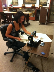 Lauren at the sewing machine making bags for storing the globe collection.